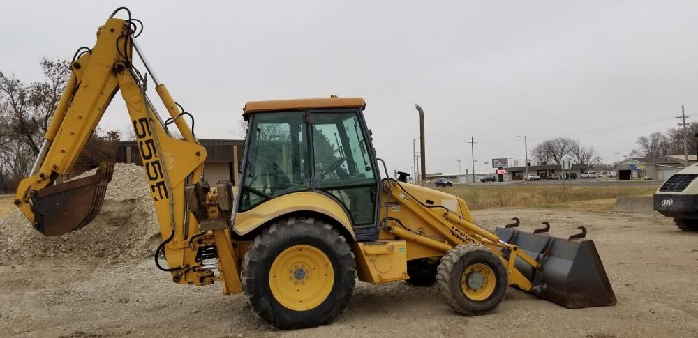 Detail photo of 1999 New Holland 555E from Construction Equipment Guide