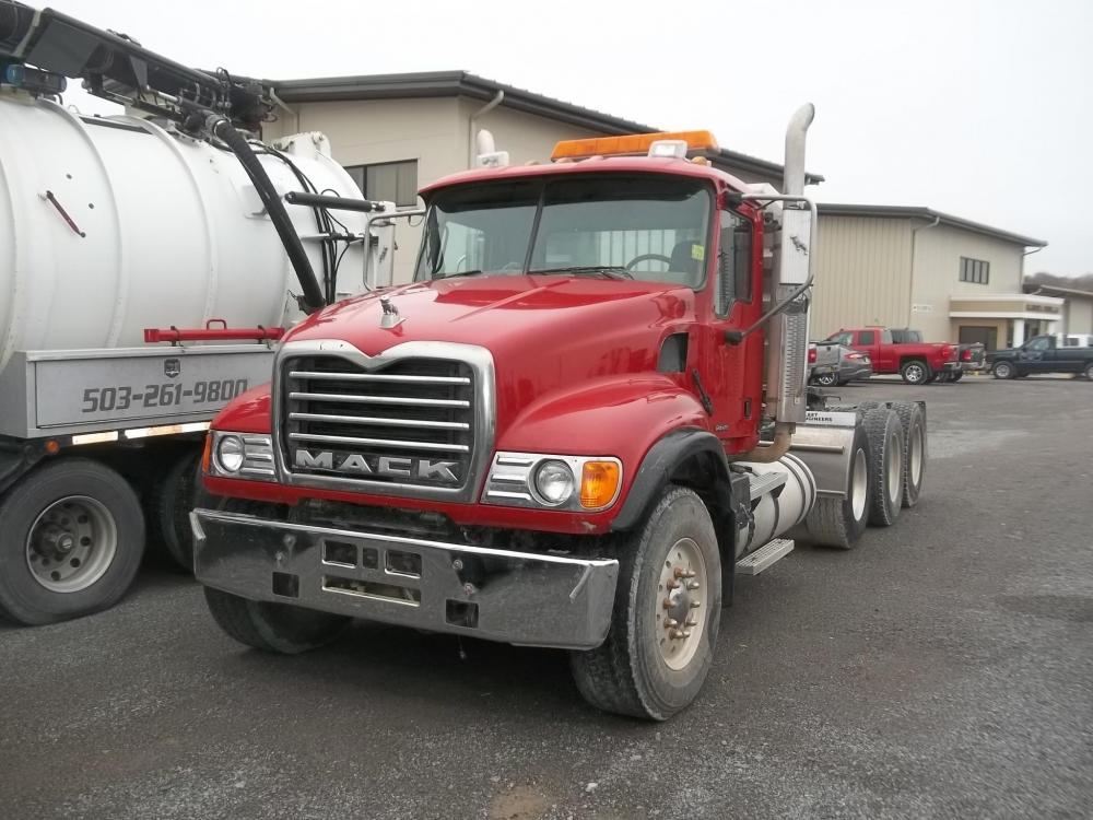 Detail photo of 2004 Mack GRANITE CV713 from Construction Equipment Guide