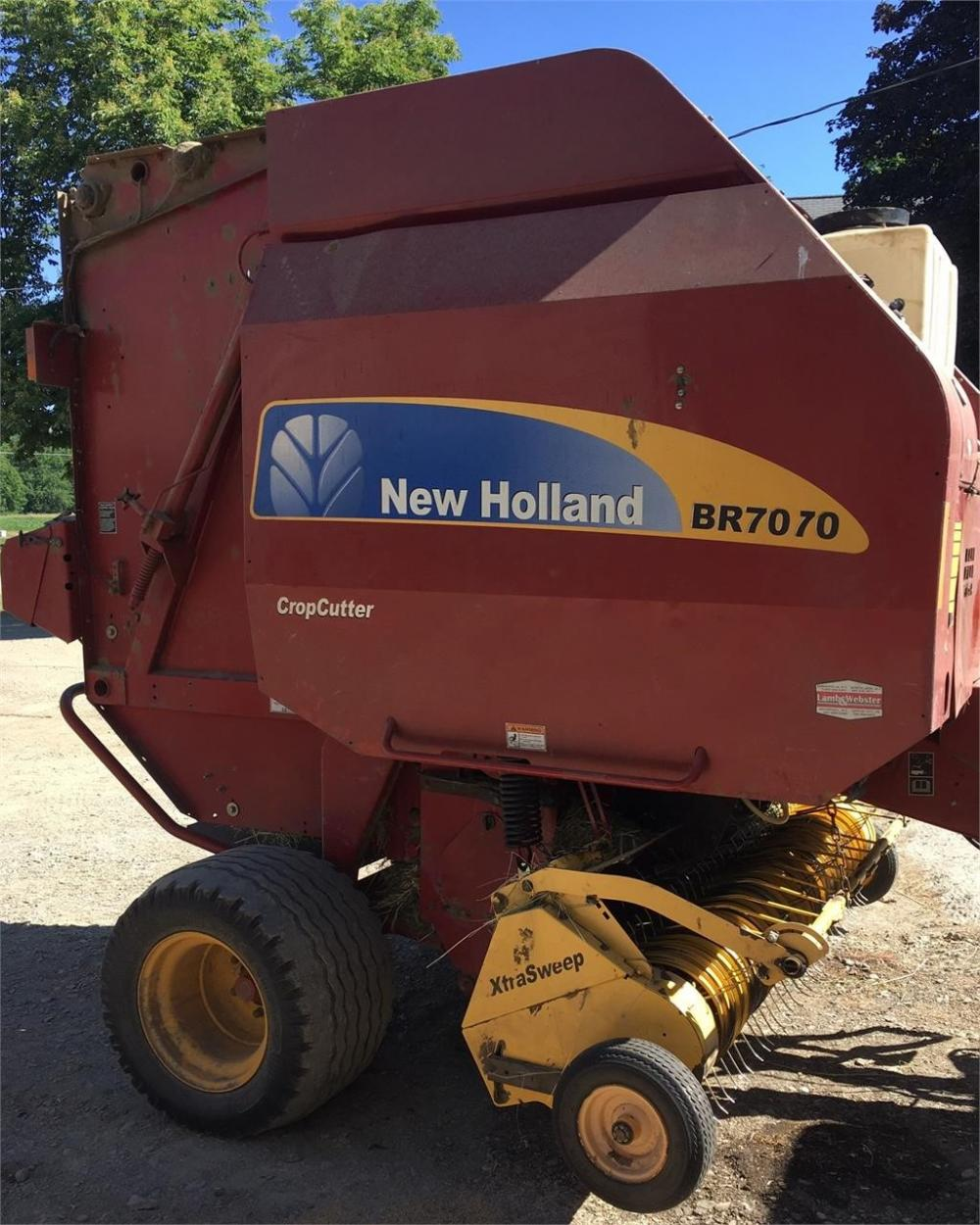 Detail photo of 2009 New Holland BR7070 from Construction Equipment Guide