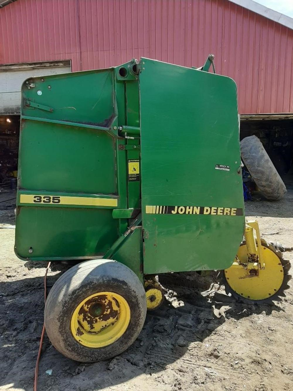 Detail photo of 1990 John Deere 335 from Construction Equipment Guide