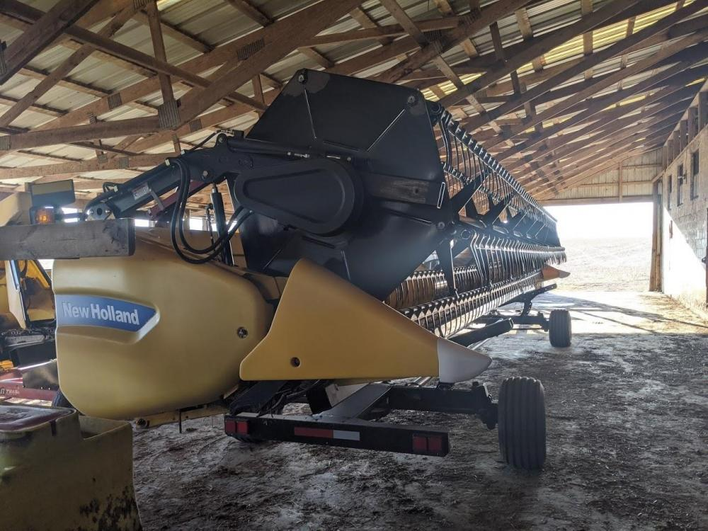 Detail photo of 2011 New Holland 740CF-30 from Construction Equipment Guide