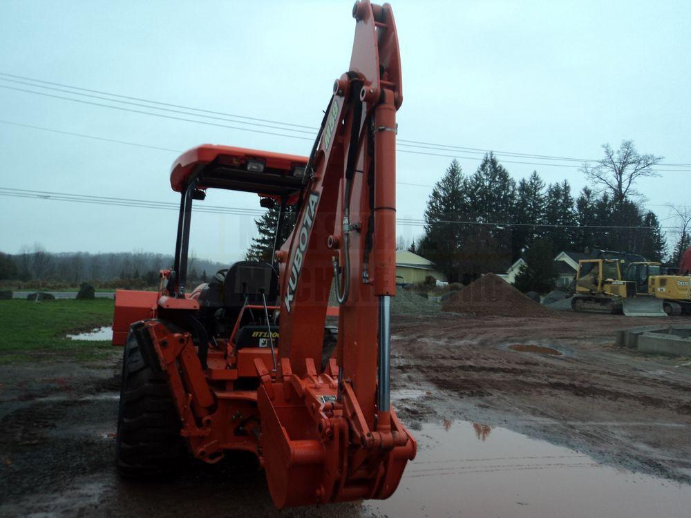 Detail photo of 2009 Kubota M59 from Construction Equipment Guide