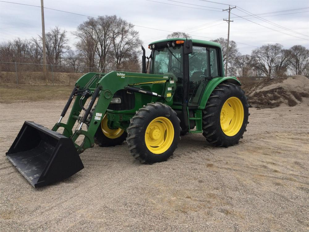 Detail photo of  John Deere 6420 from Construction Equipment Guide