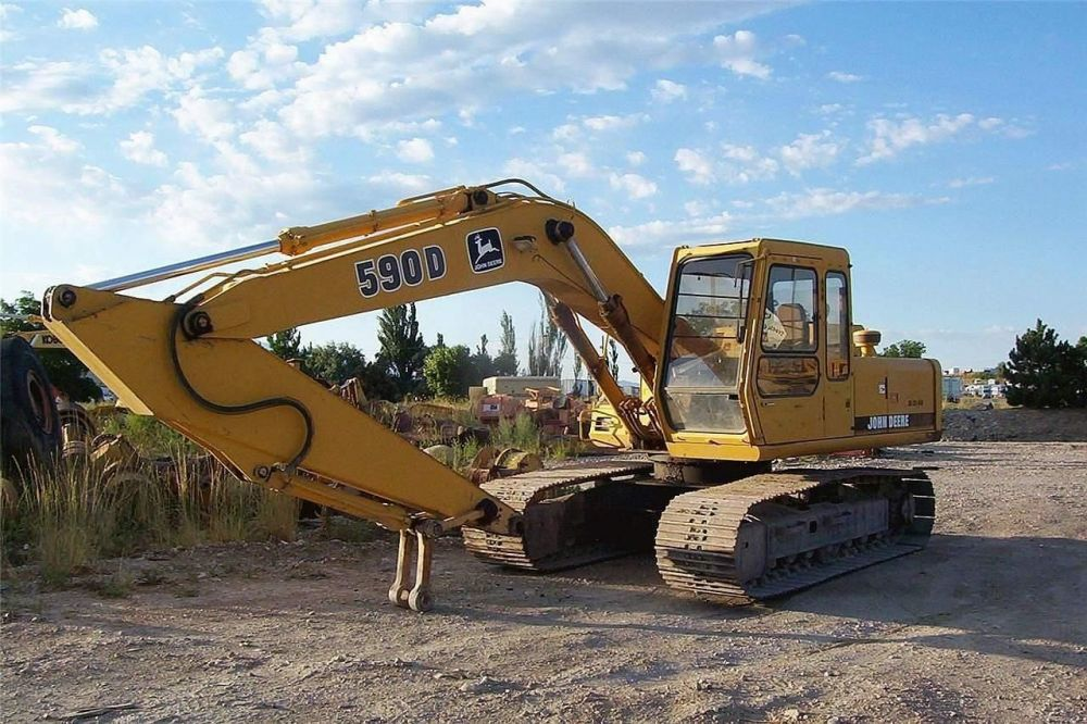 Detail photo of  John Deere 590D from Construction Equipment Guide