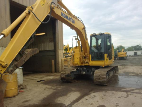 Detail photo of 2015 Komatsu PC138USLC-10 from Construction Equipment Guide